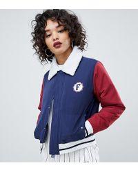 185d36eceecc Fila Hooded Festival Windbreaker Jacket With All Over Print in Black ...
