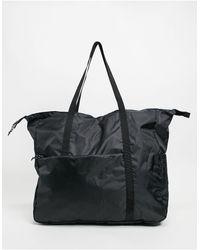 ASOS - Maxi borsa oversize ripiegabile nera da 45 litri - Lyst