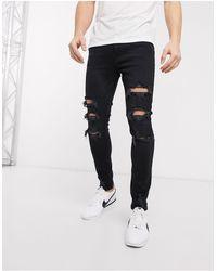 Bershka Superskinny Jeans Met Scheuren - Zwart