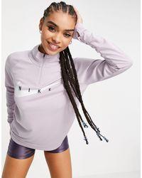 Nike Top intermédiaire à logo virgule - Lilas - Violet