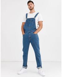 ASOS Salopette di jeans comoda blu lavaggio medio