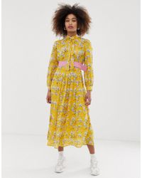 Sister Jane Belted Midi Dress With Pleated Skirt In Bright Vintage Floral - Yellow