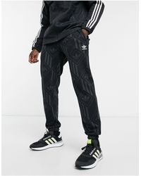 adidas Originals Joggers negros con monograma del trifolio