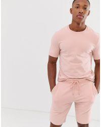ASOS Tuta rosa polvere con felpa attillata a maniche corte e pantaloncini skinny