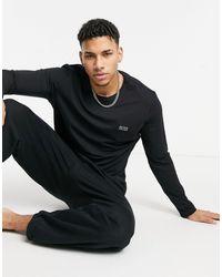 BOSS by Hugo Boss BOSS - Bodywear - T-shirt à manches longues avec logo - Noir