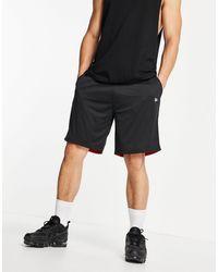 KTZ Shorts negros con diseño reversible y logo