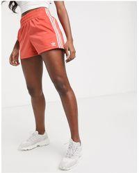 adidas Originals – Adicolor – e Shorts mit Dreierstreifen - Schwarz