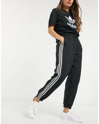 adidas Originals Черные Джоггеры С Манжетами И 3d Логотипом-трилистником -черный Цвет