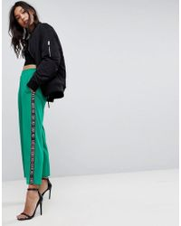 7d42028b11 ASOS - Asos Premium Scuba Wide Leg Joggers With Printed Side Tape - Lyst