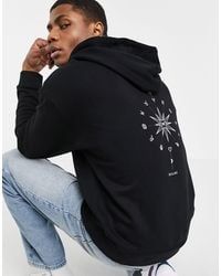 ASOS Sudadera negra extragrande con capucha y estampado místico en la espalda - Negro