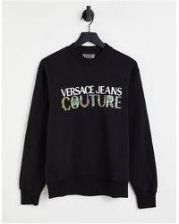Versace Jeans Couture - Felpa nera con stampa barocca e logo - Lyst