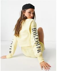 Hollister Felpa gialla con logo sulle maniche - Giallo