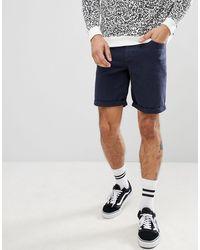 ASOS Pantaloncini di jeans slim blu navy