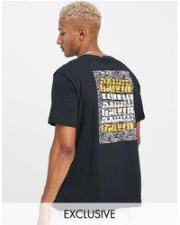Calvin Klein - Camiseta extragrande en negro con estampado - Lyst
