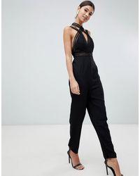 Love Triangle Tuta jumpsuit nera con spalline e incrocio frontale - Nero