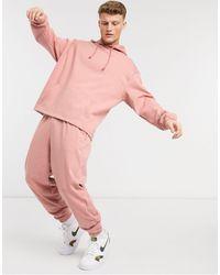ASOS Tuta sportiva oversize composta da joggers e felpa con cappuccio, colore rosa