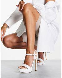 Truffle Collection Glam - sandales à semelle plateforme et talon - Blanc