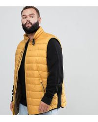North 56'4 - Quilted Gilet Vest In Mustard - Lyst