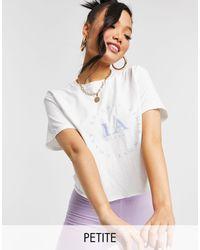 Miss Selfridge Petite - T-shirt à inscription « LA » - Blanc