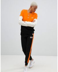 Fila Tracksuit Bottoms With Contrast Sports Stripes And Logo Detail - Black