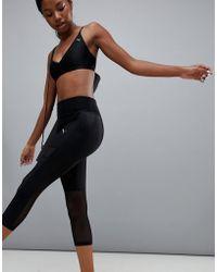 PUMA - Dance Mesh Panel Capri Leggings - Lyst