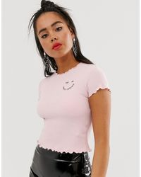 Bershka T-shirt rosa con scritta