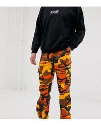 Reclaimed (vintage) - Pantalones cargo de camuflaje en naranja de Revived - Lyst