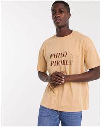 New Look T-shirt arancione con stampa