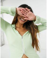 Another Reason Crop top zippé en tissu côtelé avec poignets en fausse fourrure - Vert
