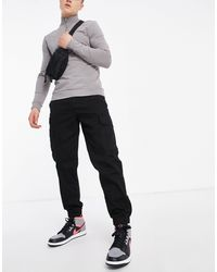 New Look Pantaloni cargo neri con fondo elasticizzato - Nero