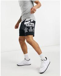 Nike Shorts negros con estampado gráfico World Tour Pack