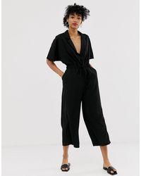 ASOS – Smoking-Jumpsuit mit weitem Beinschnitt und Taillenschnürung - Schwarz