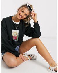 Daisy Street Sweat-shirt oversize avec imprimé tarot Le Soleil - Noir