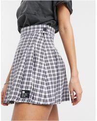 Bershka Minifalda plisada a cuadros en color malva - Multicolor