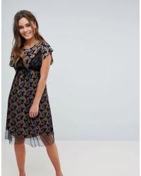 Hazel Vestido midi con capa superior de malla y estampado floral - Negro