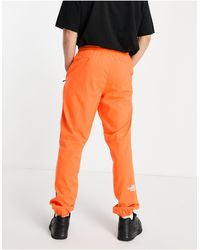 The North Face Joggers naranjas Mountain Athletic