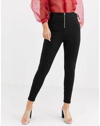 ASOS Pantaloni skinny con laccetti stile corsetto e cuciture a contrasto - Nero