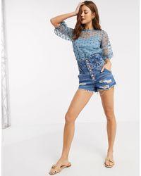 River Island Pantaloncini di jeans a vita alta stile corsetto blu medio authentic