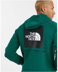 The North Face – Grüner Kapuzenpullover mit Raglanärmeln und Box-Logo - Rot