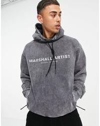 Marshall Artist Sudadera extragrande con capucha, lavado ácido y logo reflectante - Gris