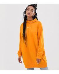 Nike Sudadera larga con capucha en naranja exclusiva en ASOS
