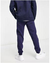 PUMA Темно-синие Узкие Джоггеры С Маленьким Логотипом Essentials-темно-синий