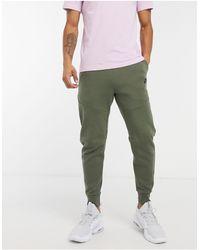 Nike - Флисовые Джоггеры Цвета Хаки Tech-зеленый - Lyst