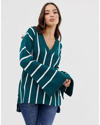 Boohoo – Exklusiver Pullover mit weiten Ärmeln, V-Ausschnitt und Streife - Blau