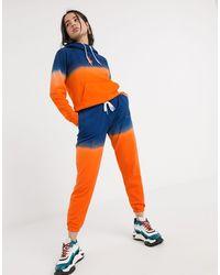 Polo Ralph Lauren – Jogginghose mit Farbblockdesign und Farbverlauf - Orange