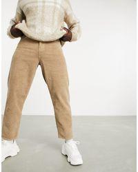 ASOS – Legere, schmal zulaufende Jeans aus Cord - Braun