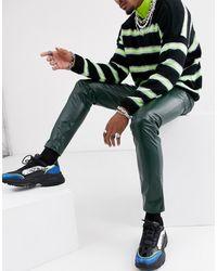 ASOS – Enge Jeans aus grünem Vinyl