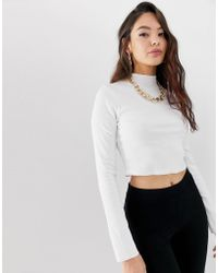 ca0b55258c981 ASOS - Long Sleeve Crop Top With Turtle Neck And Raw Hem In Rib In White