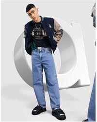 ASOS Ruimvallende Jeans Met Middenblauwe Wasing