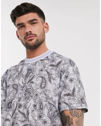 ASOS Relaxed Longline T-shirt With All Over Floral And Paisley Print - Multicolor